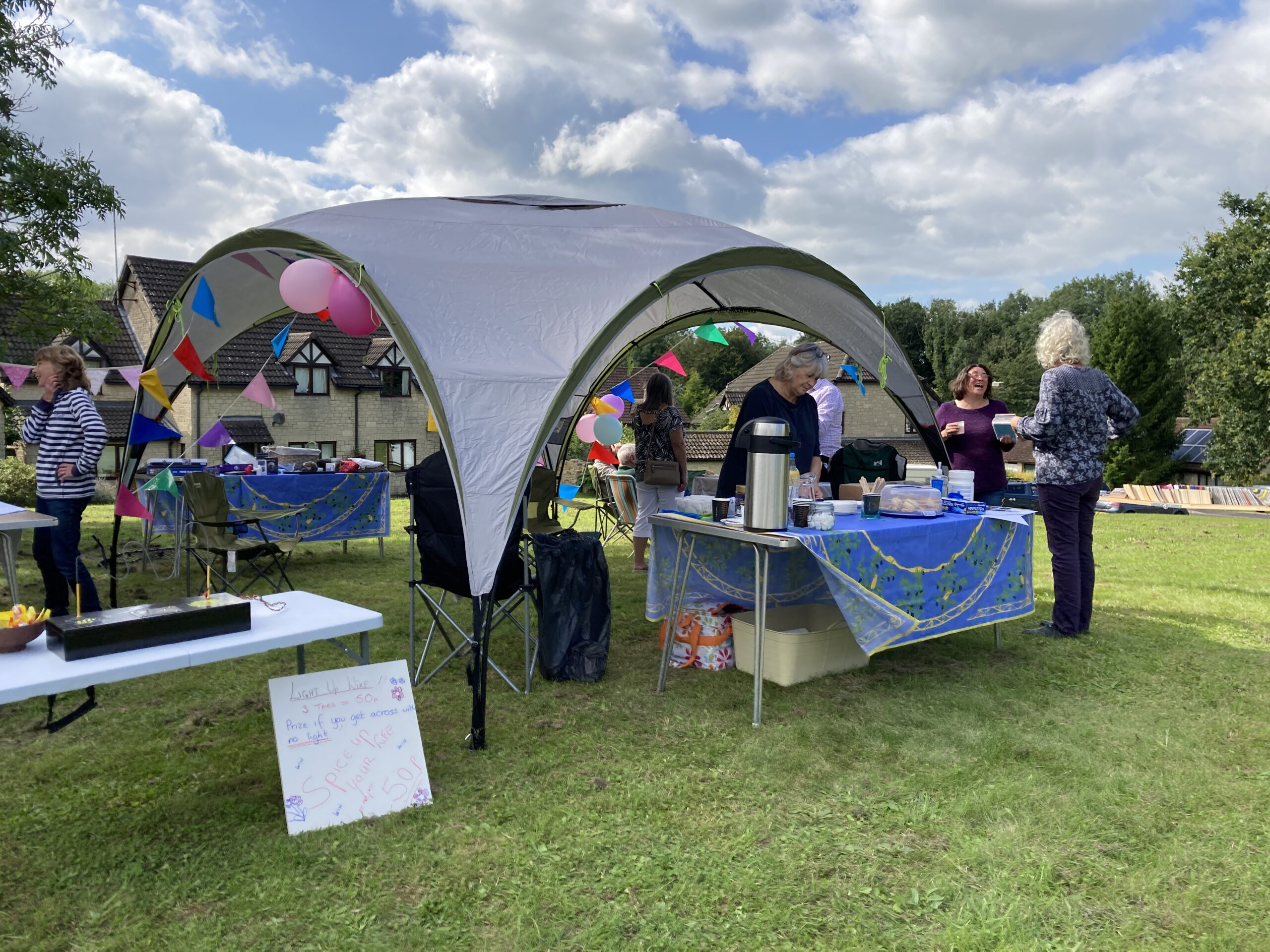 A picture of people perusing the stalls at Farleigh Rise